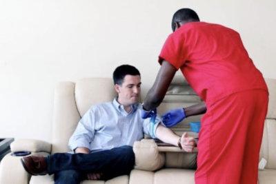 nurse injecting a man